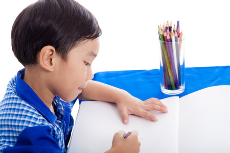 Boy drawing picture photo