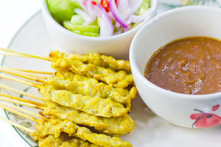 peanut sauce: Grilled pork satay thai food with peanut sauce and cucumber soup red onion