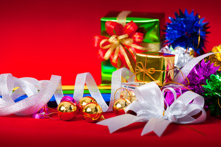 Celebration theme with christmas & new year gifts on red background photo