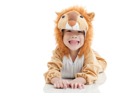 Llittle lovely asian boy trick or treat concept, lovely boy costumed and acting like a lion,stick out tongue, isolated on white background