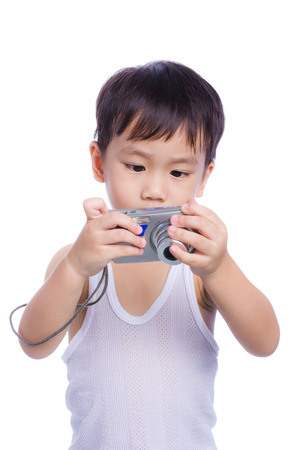 white singlet: Portrait of asian boy in a white singlet interesting digital compact photo camera with good intentions