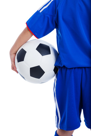 Back view of youth soccer player in blue uniform and little kid holding a ball, Isolated on white background