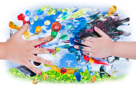 children painting: Closeup of little children hands doing finger painting with various colors on sky and green clover background. Use it for creative or imagination concept, top view