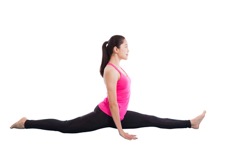 hamstrings: Asian woman practicing yoga exercise called Monkey Pose (Hanumanasana), this pose stretches the thighs, hamstrings, groins, hip flexors and lower back muscles. Isolated on white background Stock Photo