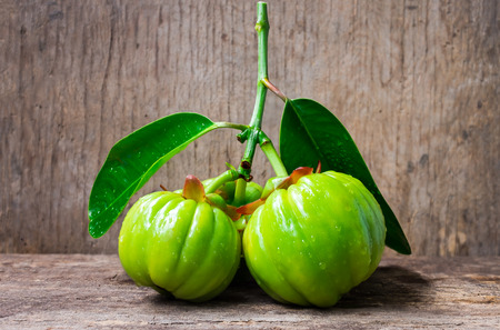 Still life garcinia atroviridis fresh fruit on old wood background.