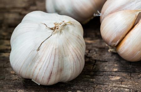 garlic: Close up. Still life with organic garlic bulbs on wooden background. Stock Photo
