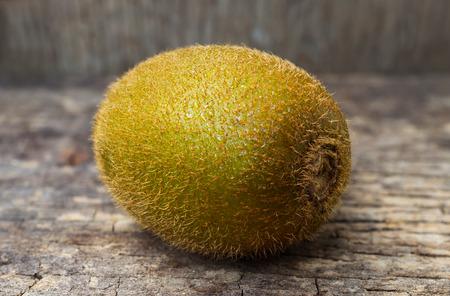 nutritive: Close up fresh kiwi fruit on old wood background. Kiwi fruit is sweet and sour taste, nutritive value and high-fiber.