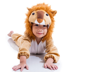 Llittle lovely asian boy costumed and acting like a lion with drop shadow. Isolated on white background. Full body. Free form copy space