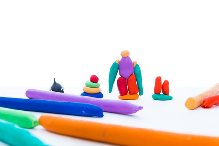 clay modeling: Creative clay model. Hand made plasticine or modeling clay, isolated on white background. Play dough