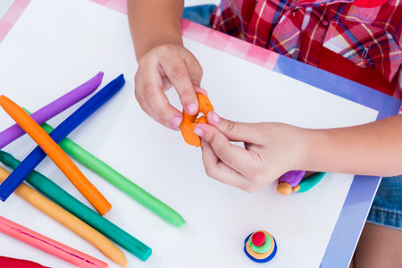 strengthen: Close up childs hand creating toys from play dough. Strengthen the imagination of child Stock Photo