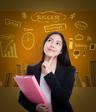 way of thinking: Beautiful woman looking up with finger at face and holding pink document folder on brown business background. Decision making process concept. Asian female thinking many ideas way to success.