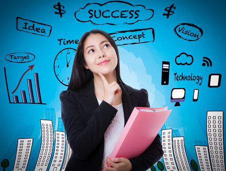 way of thinking: Beautiful woman looking up with finger at face and holding pink document folder on blue business background. Decision making process concept. Asian female thinking many ideas way to success. Stock Photo