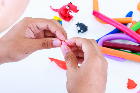 strengthen hand: Child playing and creating toys from play clay.