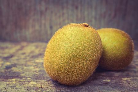 nutritive: Close up fresh kiwi fruit on old wood background. Kiwi fruit is sweet and sour taste, nutritive value and high-fiber. Selective Focus.