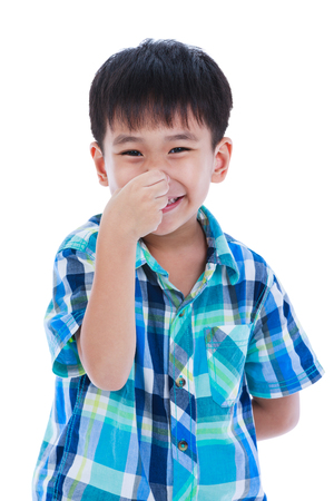 olfactory: Playful asian boy covering his nose. Isolated on white background. Positive human emotion, facial expression feeling reaction. Studio shot.