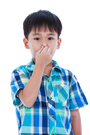 Portrait of asian handsome boy covering his nose. Isolated on white background. Negative human emotion, facial expression feeling reaction. Studio shot.