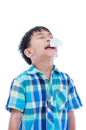 rheum: Asian boy using tissue to wipe snot from his nose. Child with allergy symptom. Isolated on white background. Negative human emotion, facial expression feeling reaction. Studio shot.