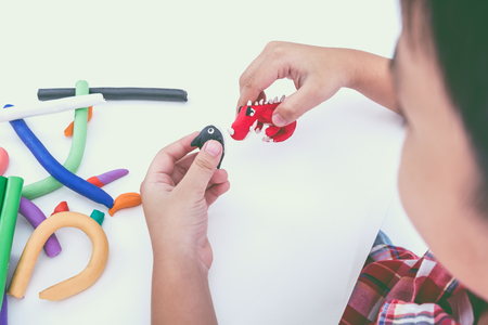 strengthen hand: Little asian boy playing and creating toys