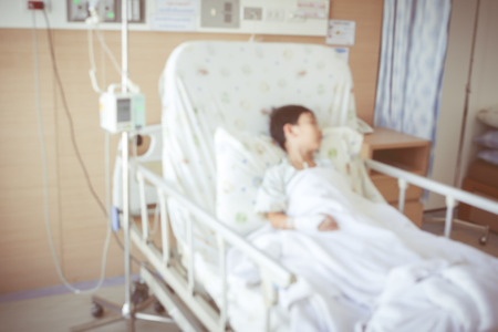 sickbed: Abstract blurred background of illness asian child admitted at modern and comfortable equipped hospital room with infusion pump intravenous IV drip.