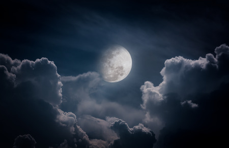 nightly: Attractive photo of a nighttime sky with clouds, bright full moon would make a great background. Nightly sky with large moon. Beautiful nature use as background. Outdoors.