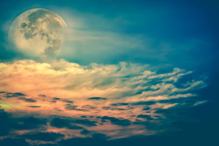 cross process: Attractive photo of a beautiful sky with clouds, bright full moon would make a great background. Beauty of nature use as background. Outdoors. Cross Process. Stock Photo
