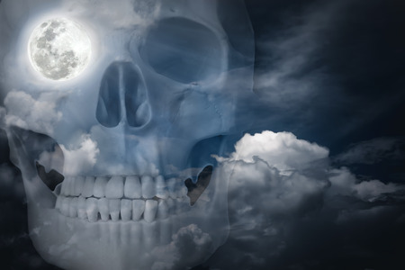 eye socket: Halloween horror night background. Double exposure of human skull combined sky with clouds . Full moon on right eye socket. The moon taken with my own camera, no NASA images used.