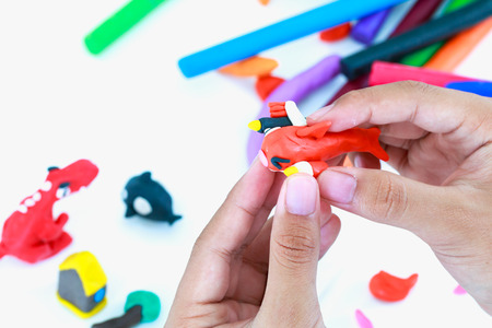 strengthen hand: Close up. Child playing and creating toys   . Child molding model clay. Strengthen the imagination of child.
