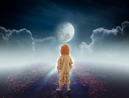 nightly: Back view of child costumed like a lion on pathway with a nightly sky and a large moon for halloween background. The moon taken with my own camera, no NASA images used.