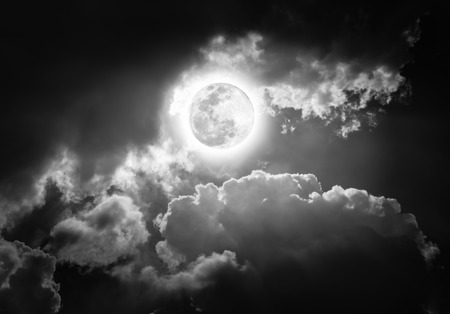 moonbeam: Attractive photo of a nighttime sky with clouds, bright full moon would make a great background. Beauty of nature in black and white. The moon taken with my own camera, no NASA images used.