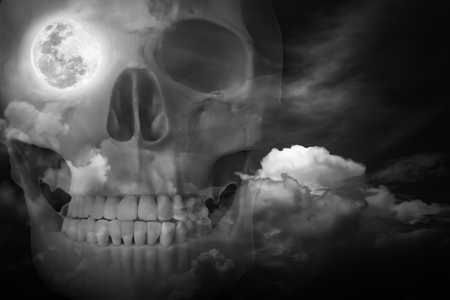 eye socket: Halloween horror night background. Double exposure of human skull combined sky with clouds . Full moon on right eye socket. Black and white style. Stock Photo