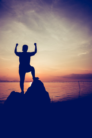 arm up: Silhouette of successful woman relax and showing arm up gesture. Action of winner. Vignette picture style.