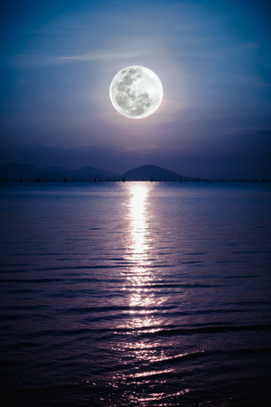 full moon romantic night: Fantastic view of the sea. Romantic scenic with full moon on sea to night. Reflection of moon in water.