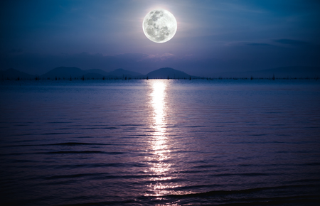 not full: Fantastic view of the sea. Romantic scenic with full moon on sea to night. Reflection of moon in water. The moon were NOT furnished by NASA.