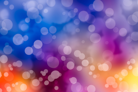 Defocused bokeh. Twinkling lights vivid background for Christmas and Happy new year holiday. Festive elegant abstract blurred background with colorful bokeh circular and bright lights.