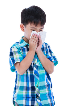 rheum: Child blow the nose. Asian boy using tissue to wipe snot from his nose. Child with allergy symptom. Isolated on white background. Negative human emotion, facial expression. Studio shot.