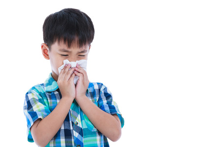rheum: Child blow the nose. Asian boy using tissue to wipe snot from his nose and free form copy space. Child with allergy symptom. Isolated on white background. Studio shot.