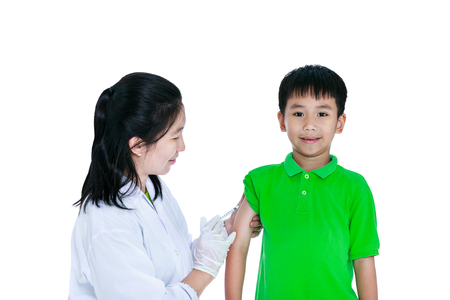 Doctor vaccinating boy's arm. Asian illness boy get  vaccination or antibiotic in hypodermic syringe. Isolated on white background.  Human health care and medical concept.