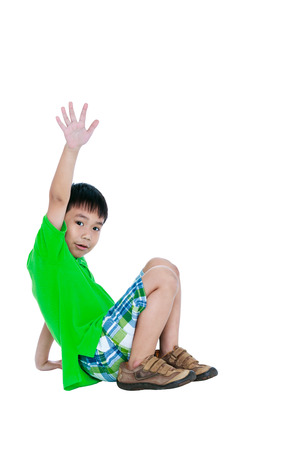 feeling up: Full body of happy asian child smiling and raising his hands up, isolated on white background. Handsome child looking at camera. Positive human emotion, facial expression feeling reaction. Studio shot.