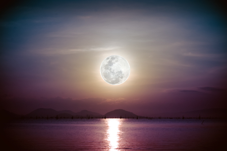 full moon romantic night: Fantastic view of the sea. Romantic scenic with full moon on sea to night. Reflection of moon in water. Vignette picture style. The moon were NOT furnished by NASA.