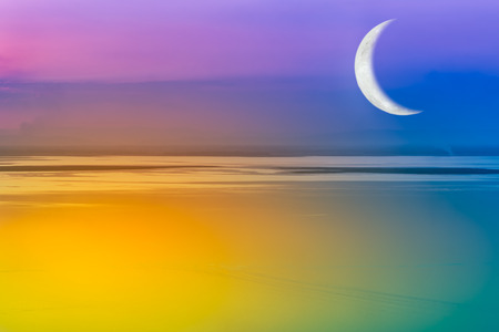 crescent lake: Moon crescent and colorful sky. Romantic scenic with crescent moon over fantastic sea just after sunset. Outdoors. The moon were NOT furnished by NASA.