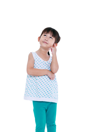 child looking up: Adorable asian girl thinking and smiling. Thoughtful child looking up, isolated on white background with copyspace. Studio shot.