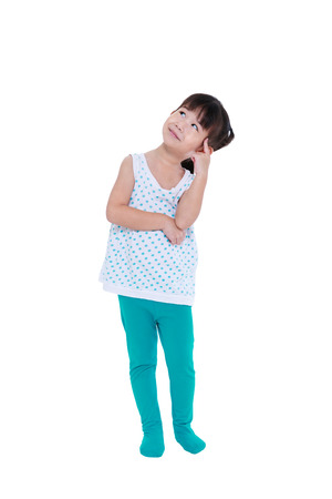 child looking up: Full body of adorable asian girl thinking and smiling. Thoughtful child looking up, isolated on white background with copyspace. Studio shot.