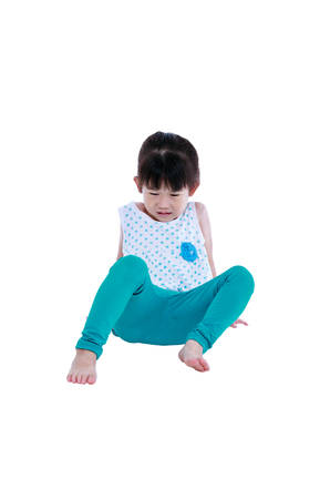 Full body of child got accident. Sad asian girl fall down and feel pain. Isolated on white background. Studio shot. Human healthcare and problem concept.
