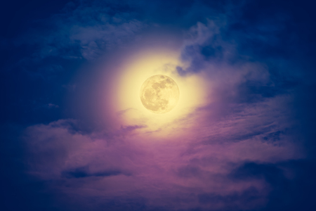 full moon effect: Attractive photo of a nighttime sky with cloudy and bright full moon. Nightly sky with beautiful full moon. Outdoors at night. Vintage effect tone. The moon were NOT furnished by NASA. Stock Photo