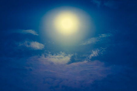 Background of nighttime sky with cloud and full moon with shiny. Natural beauty at night. Cross process and vintage effect tone. The moon were NOT furnished by NASA.