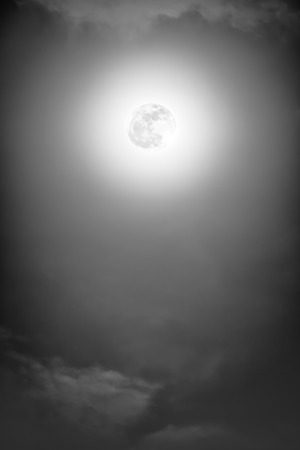 full moon effect: Background of nighttime sky with cloud and full moon with shiny. Natural beauty at night in black and white style. Vintage effect tone. The moon were NOT furnished by NASA.