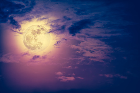 full moon effect: Background of nighttime sky with cloud and bright full moon with shiny. Natural beauty at night with beautiful full moon behind cloud. Vintage effect tone. The moon were NOT furnished by NASA.