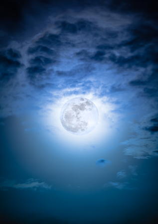 nightly: Attractive photo of background nighttime sky with clouds and bright full moon with shiny. Nightly sky with beautiful full moon. Outdoors at night. The moon were NOT furnished by NASA.