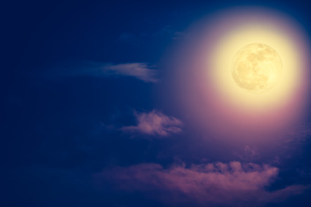 full moon effect: Background of nighttime sky with cloud and bright full moon with shiny. Natural beauty at night with beautiful full moon. Vintage effect tone. The moon were NOT furnished by NASA.