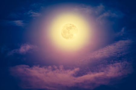 Background of nighttime sky with cloud and bright full moon with shiny. Natural beauty at night with beautiful full moon. Vintage effect tone. The moon were NOT furnished by NASA.